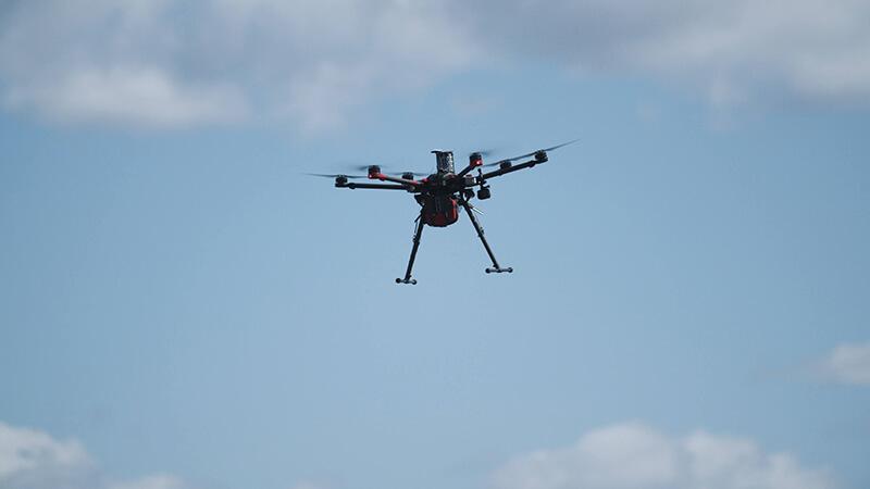 Drone delivering a defibrillator to a patient